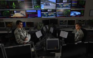 Two U.S. Air Force space and cyber airmen work in the Global Strategic Warning and Space Surveillance Systems Center at Cheyenne Mountain Air Force Station, Colorado, image via afcea.org