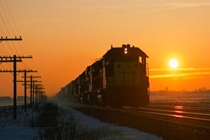 train on track at sunset