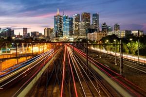 night photo of city with blurred lights representing broadband