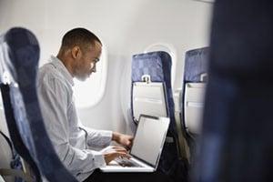 man on plane working