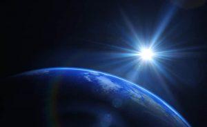 sun coming over earth