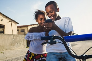 kids in remote location on cellphone from cell backhaul
