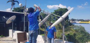 Workers restoring communications on the island of Vanuatu in the Solomon Islands.