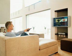 gentleman in eastern europe watching tv at home