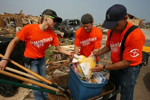 volunteers cleaning up after a disaster