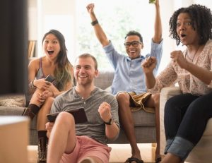 people excited to be watching tv